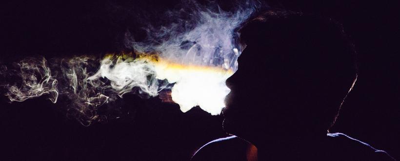 shadowy figure smoking