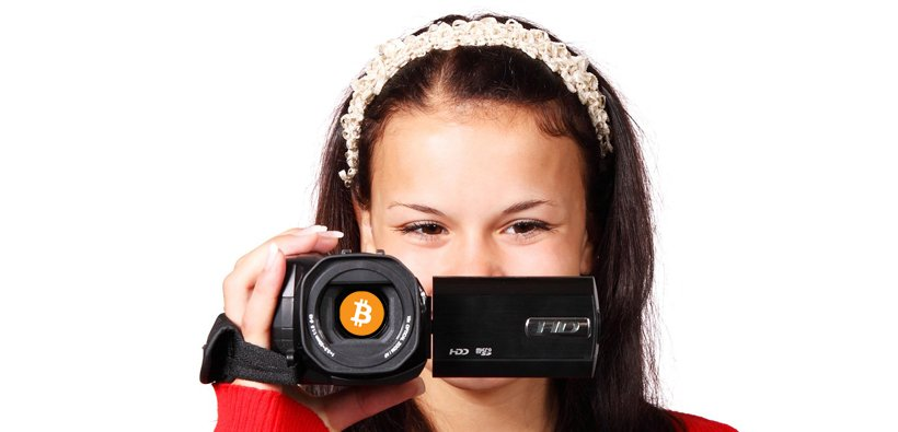 woman holding bitcoin camera