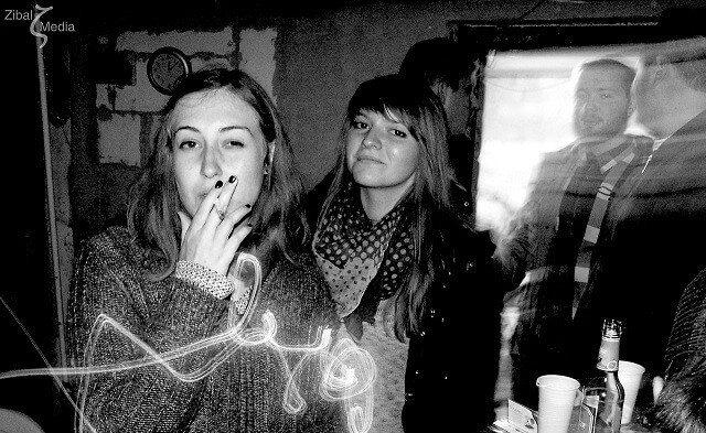 Smoking Girl At A Party